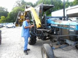 Man fixing tractor